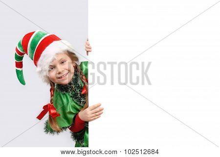 Girl In Suit Of Christmas Elf
