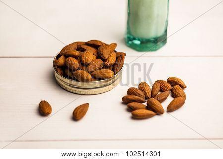 Close up of almonds on jar lid