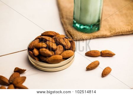Almonds in a jar lid on the table