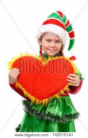 Girl in suit Santa's elf holds heart .