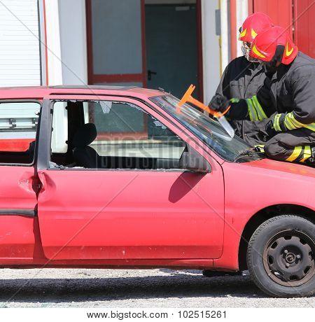 Chief Fireman Whit Red Helmet Break The Car Glass