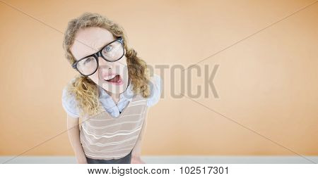 Confused geeky hipster woman against room with wooden floor