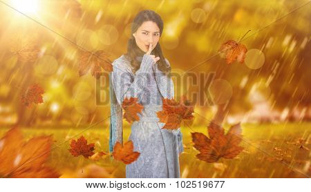 Young model with winter clothes keeping secret against park
