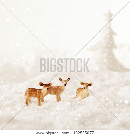 roe deer group in winter snow - christmas decoration