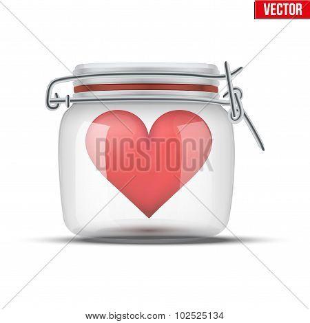 Red heart inside glass jar.
