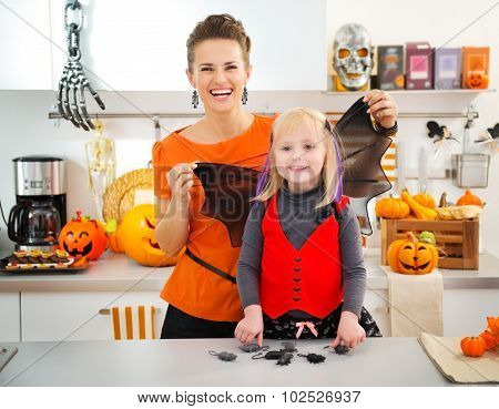 Funny Halloween Dressed Girl With Mother In Kitchen