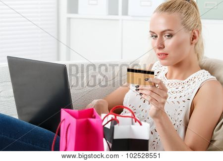 Beautiful Blonde Woman Making Shopping