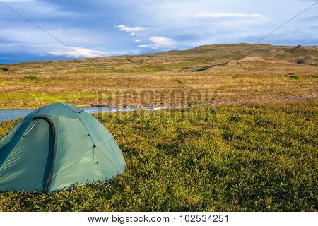 Camping tent on a river shore in Iceland