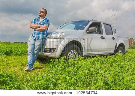 Man standing in front of car