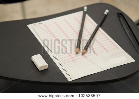 Pencils and eraser put on Optical mark recognition sheet in examination room, ORM Sheet, Concept for