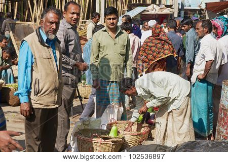 Men buy fruits at the local market in Bandarban, Bangladesh.