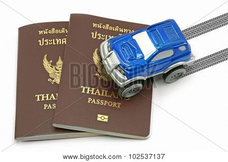 Thailand Passport And Blue 4Wd Car For Travel Concept