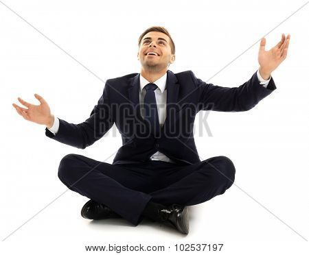 Elegant man in suit sitting isolated on white