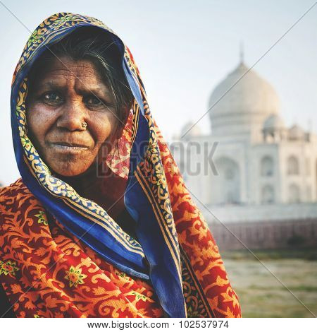 Indigenous Indian Woman And Taj Mahal Background Concept