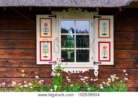 Wooden facade with a retro (vintage) painted shutters