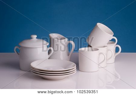 Porcelain coffee cups, milk jug and sugar pot