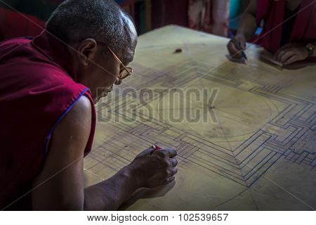 Monk Working On Mandala In Diskit Gompa, Ladakh