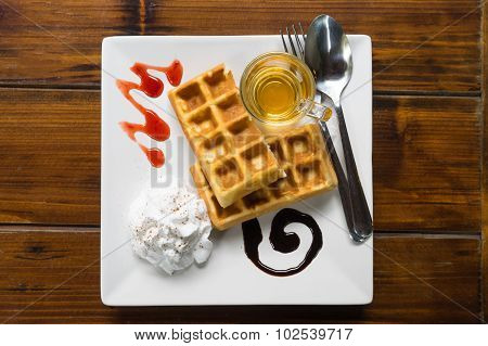 Tasty Waffles On Wood Table