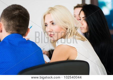 Thoughtful Young Business Woman With A Group Of Business People At The Meeting