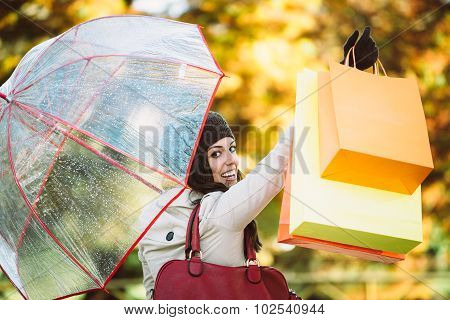 Woman After Shopping Raising Bags In Autumn