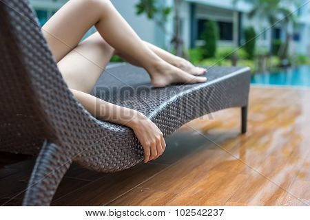 Woman Relaxing In Deck Chair Focus Hand