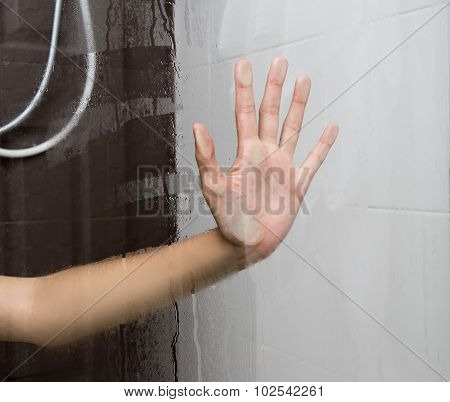 Woman Hand Behind Glass 1