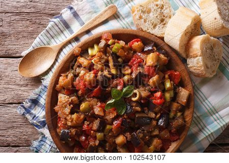 Italian Caponata With Aubergines Closeup In A Plate. Horizontal Top View