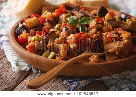 Sicilian Caponata With Aubergines Closeup On Wooden Plate. Horizontal