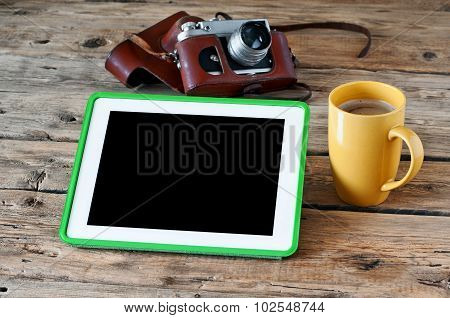 White Tablet Computer With A Coffee And A Old Chamber