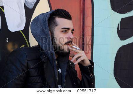 Young Hispanic Man Smoking