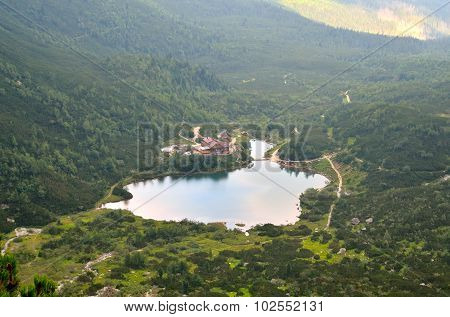 Summer landscape. Lake and mountain chalet.