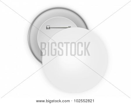 Two blank white circular pins isolated on a white background.