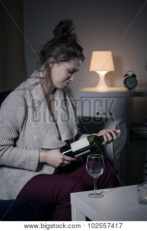 Woman Opening Bottle Of Wine