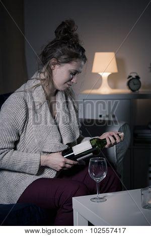 Woman Opening Bottle Of Wine