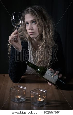 Alcoholic Looking On A Glass