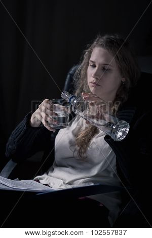 Alcoholic Woman Pouring Vodka