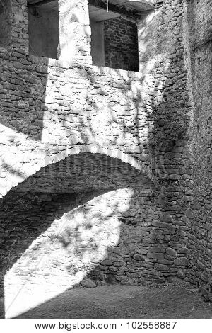 Dogliani (Cuneo): the old city wall detail. Black and white photo