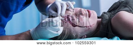 Surgeon Stitching Up Head