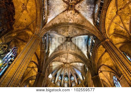 BARCELONA, SPAIN - MAY 02: Low Angle Architectural View of Interior of Historic Barcelona Cathedral, Looking Up at Vaulted Nave Ceiling Illuminated in Warm Light, May 02, 2015