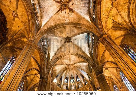 BARCELONA, SPAIN - MAY 02: Architectural Detail of Apse with Vaulted Ceiling Illuminated in Warm Light Inside Historic Barcelona Cathedral, Barcelona, Spain, May 02, 2015