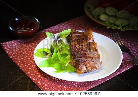 Grilled beef steak with salad and sauce on wooden table