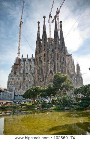 BARCELONA, SPAIN - MAY 02: Exterior of Sagrada Familia Church Topped with Construction Cranes, Designed by Antoni Gaudi, Barcelona, Spain, May 02, 2015