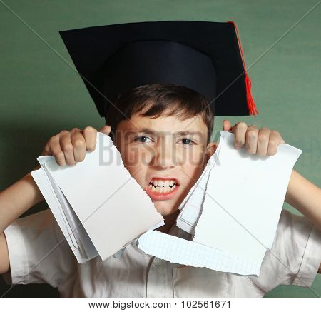 School Boy In Graduation Cap Rebel Against Hard Learning