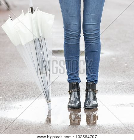Feet Rain Boots And Umbrella, Autumn And Winter Lifestyle Concept.