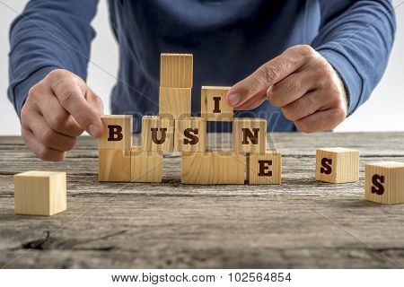 Man Building The Word Business With Blocks