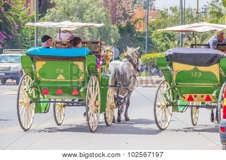 MARRAKESH, MOROCCO, APRIL 3, 2015: Jemaa el-Fnaa square - Horse drawn carriages for tourists