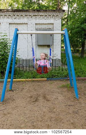 Little Girl With Pigtails On Swing