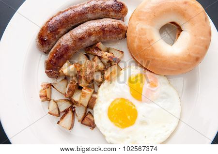 Sausage, Eggs And Bagel Breakfast