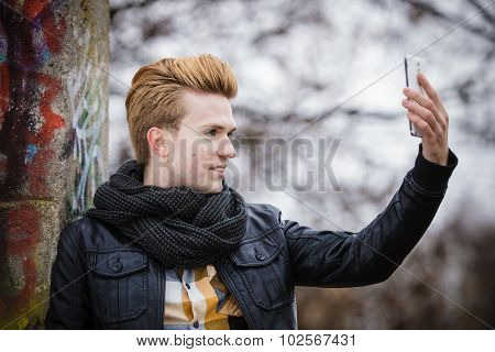Guy Taking Self Picture With Phone Outdoors