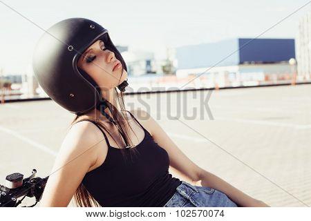 Biker Girl In Helmet Sitting On Custom Motorcycle